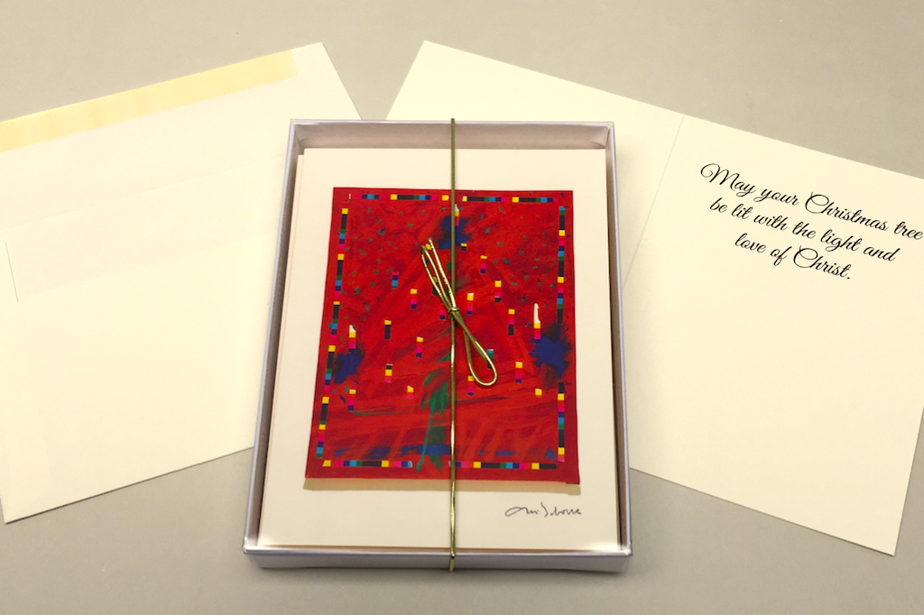 The bright, red abstract painting of a Christmas tree is on the front of a card.